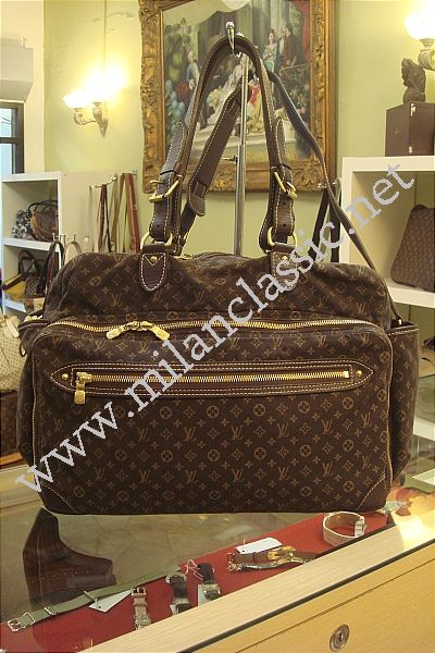 sold lv monogram mini lin sac a langer diaper bag. Black Bedroom Furniture Sets. Home Design Ideas