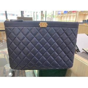 CHANEL O Case Boy Clutch Lambskin Navy Blue